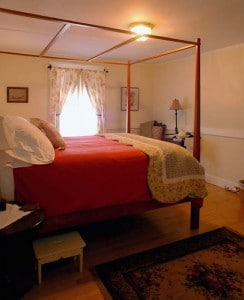 An extra high bed with step stool in our Downeaster Room.